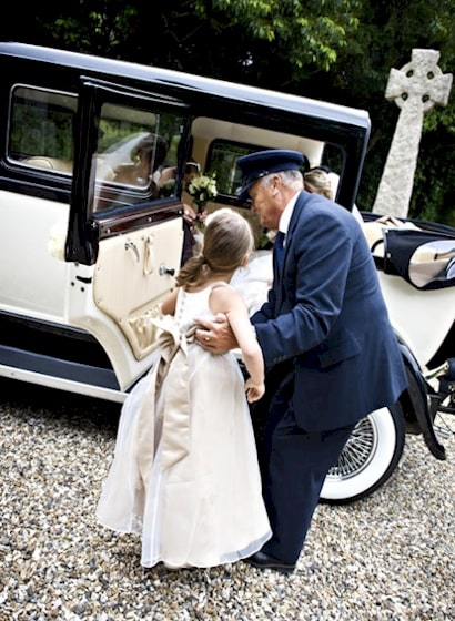 Driver helping the Bridesmaids into our Bramwith Limousine