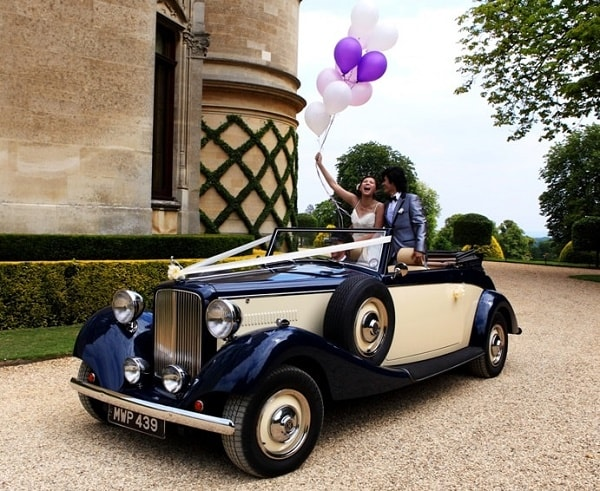 Jaguar drophead convertible with the Bride and Groom