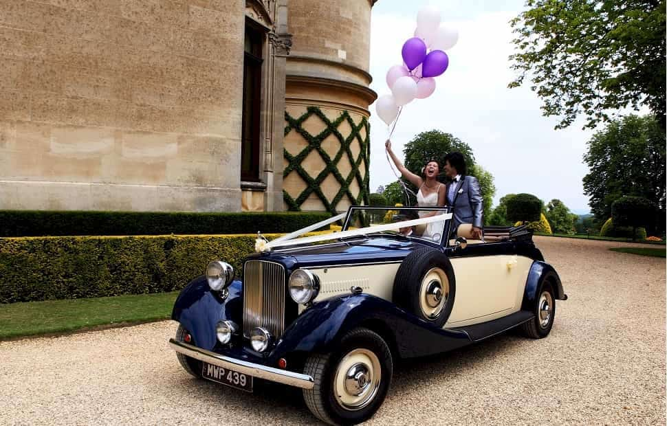 Jaguar Royale Drophead convertible with the bride and groom at Waddesdon Manor