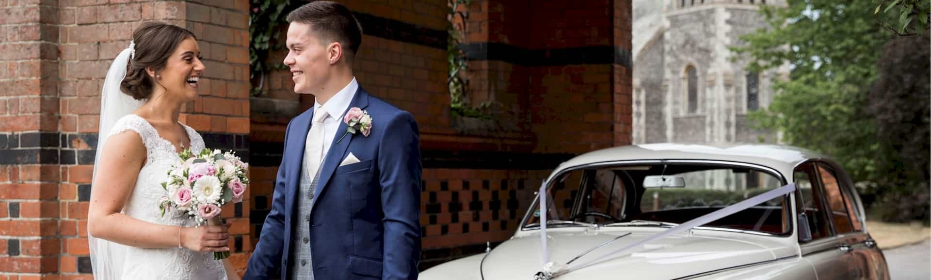 Jaguar Mk2 together with the Bride and Groom