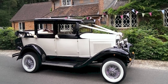 Side view of Badsworth wedding car with hood down