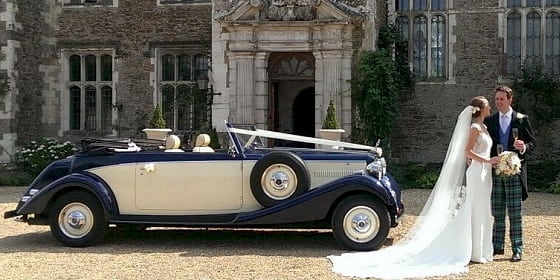 Jaguar drophead with the Bride and Groom and their chauffeur