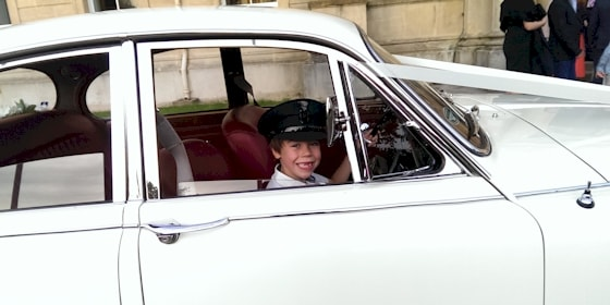 Jaguar Mk2 with young driver